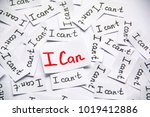 Small photo of I can. Words of motivation. Concept motivational message of ability and possibility. I can`t and i can are written on peaces of white paper.