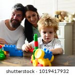 mom  dad and boy build out of... | Shutterstock . vector #1019417932