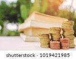 a stack of books and glasses on ... | Shutterstock . vector #1019421985