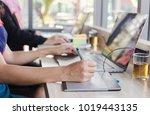 a creative business writes... | Shutterstock . vector #1019443135