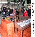 Small photo of Visitors at the pyramid of Mosin rifles. St. Petersburg, Russia - 7 May, 2017. Visitor in the exhibition pavilion of the Patriotic Association of Lenrezerv.