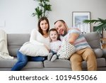 photo of happy parents with son ... | Shutterstock . vector #1019455066