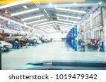abstract blur car technicians... | Shutterstock . vector #1019479342