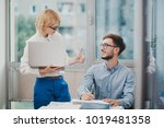 two colleagues monitoring... | Shutterstock . vector #1019481358
