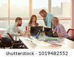 web designers creating new... | Shutterstock . vector #1019482552