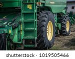 Small photo of Bulgaria, Varna 26.02.1017- John Deere. Agricultural machinery. Agro-technology.Closeup of tractor after plowing. Wheels covered with mud. Agronomy, agriculture,concept.