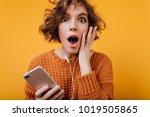 shocked dark eyed girl with... | Shutterstock . vector #1019505865