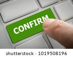 Small photo of Close view of male hand touching the confirm button. Business and finance concept.
