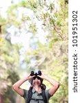 Binoculars - man hiker looking up at copy space during outdoors hiking trip. - stock photo