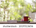 red coffee cup with big pink... | Shutterstock . vector #1019513656