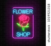 glowing neon sign of flower... | Shutterstock .eps vector #1019521318