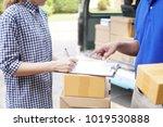 woman signing receipt of box... | Shutterstock . vector #1019530888