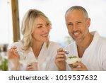 couple in bathrobes having... | Shutterstock . vector #1019537632
