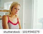 woman'standing in living room   Shutterstock . vector #1019540275