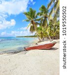 wooden boat on the beach of... | Shutterstock . vector #1019550502