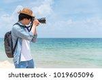 young asian man photographer...   Shutterstock . vector #1019605096