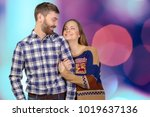 cheerful young couple standing  | Shutterstock . vector #1019637136