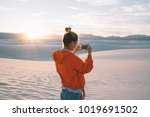 back view of young woman using... | Shutterstock . vector #1019691502
