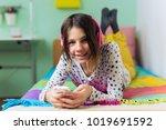 happy young teenage girl... | Shutterstock . vector #1019691592