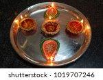 diwali oil lamp in silver plate   Shutterstock . vector #1019707246