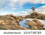 mature backpacker on a mountain ... | Shutterstock . vector #1019738785