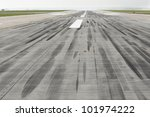 Skid marks on at the airport runway - selective focus - stock photo