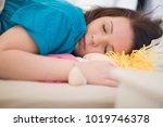 teenage girl sleeping with rag...   Shutterstock . vector #1019746378