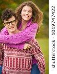 teenage couple hugging in park   Shutterstock . vector #1019747422