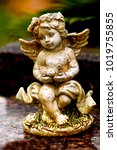 Closeup Of A Old Cupid Angel...