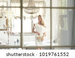 fashion portrait of a beautiful ... | Shutterstock . vector #1019761552