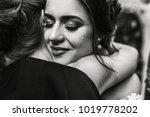 bride closes her eyes hugging... | Shutterstock . vector #1019778202