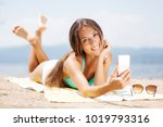 sexy girl with smartphone... | Shutterstock . vector #1019793316