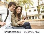 Portrait Of Tourists Using A...