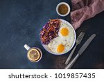 fried eggs with a salad of blue ... | Shutterstock . vector #1019857435