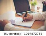 man signing paperwork  new home ... | Shutterstock . vector #1019872756