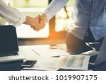 handshake between two... | Shutterstock . vector #1019907175