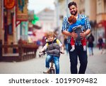 happy father and two sons on... | Shutterstock . vector #1019909482