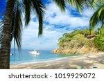 on a beautiful private beach... | Shutterstock . vector #1019929072