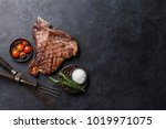 grilled t bone steak on stone... | Shutterstock . vector #1019971075