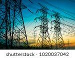 sun setting behind the... | Shutterstock . vector #1020037042