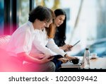 young coworkers team analyze... | Shutterstock . vector #1020039442