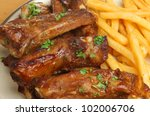 Pork ribs with southern fries - stock photo