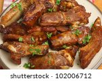 Marinated pork ribs and southern fries - stock photo