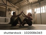 couple exercising together at... | Shutterstock . vector #1020086365