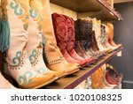Cowboys boots on a shelf in a store, aligned - stock photo