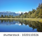 view of the lake by sunny day.... | Shutterstock . vector #1020110326