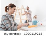 young smiling couple renovating ...   Shutterstock . vector #1020119218