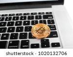 one golden bitcoin as world... | Shutterstock . vector #1020132706
