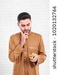 a thoughtful muslim businessman ... | Shutterstock . vector #1020132766