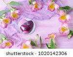 Stock photo pink cake heart with flowers 1020142306